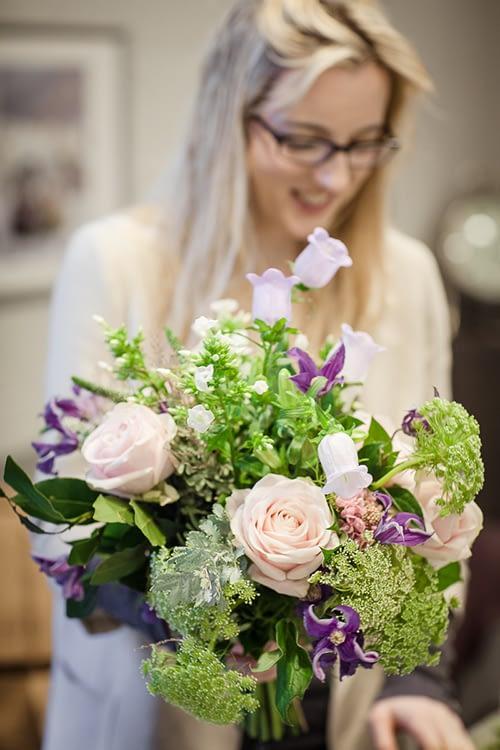 Masterclass Student Holding Flower Arrangement