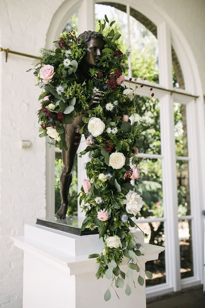 Roses Peonies Eucalyptus Flower Arrangement on Statue